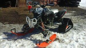 Atv with skis and tracks