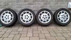 Set of 205 55 16 Nissan Maxima Mags & Winter Tires