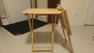 Two wooden folding side tables
