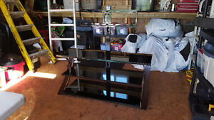 Flat tv stand with colored glass shelves
