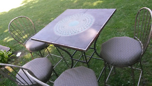 Outdoor table with chairs that swivel