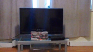 PS3/22games/TV/TV stand for sale.