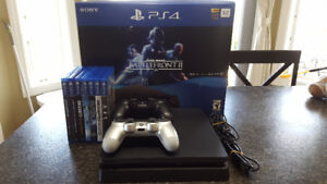Ps4 1TB with 2 controllers and 7 games $450 excellent condition