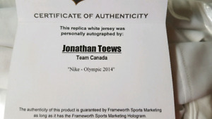 Autographed toews hockey jersey