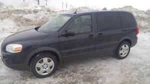 2009 Pontiac Montana SV6 Minivan All season and Winter tires.