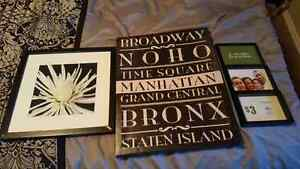 2 wall hangings and a picture frame