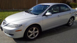 2004 Silver Mazda 6 - Black leather interior. Good condition.