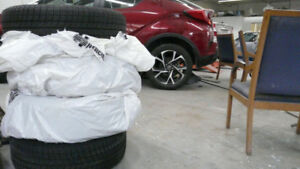 215 / 60 / R16 Michelin Snow Tires on Used Aluminum Lexus Rims.