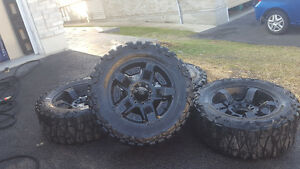 "Nitto mud grappler 35"" x 12.5 w fits 20"" rims"