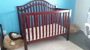 Gently used mahogany crib and changing table set for sale