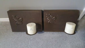 Set of 2 wrought iron sconces with candles.