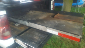 Slide out truck bed