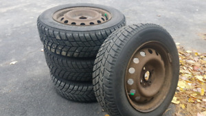 """4 14"""" 4 x100 STEEL RIMS AND STUDDED WINTER TIRES"""