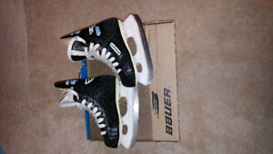 Bauer Charger hockey skates for a child are for sale.