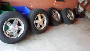 GMC 235/70/r16 rims and tires