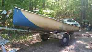 Older Albacore sailboat with trailer