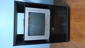 """TV stand and 21"""" tv with remote in good condition."""
