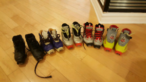 Various kids cross country skis and boots
