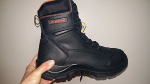 Brand new size 11 work boots. CSA approved kevlar toe plate.