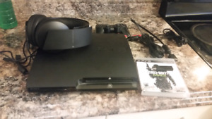 Ps3 console with headset and controllers