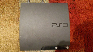 PLAYSTATION 3 WITH THREE CONTROLLERS GAMES AND ACCESSORIES
