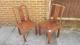 2 heavy weighted solid wood chairs - upcycle project for someone