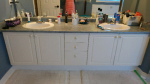 Bathroom reno tub, vanity, light fixture, mirror