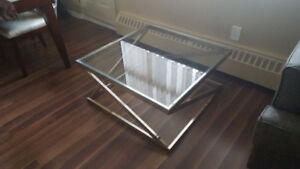 Like new 1 year old beautiful glass table.