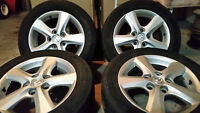 "4- 15"" Mazda 3 Stock Alloy Rims Mounted With Goodyear Tires"
