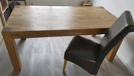 Homebase solid wood table and 6 brown leather chairs