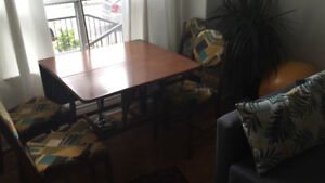 Solid wood table and four retro upholstered chairs