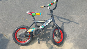 14inch bike. Comes with traoning wheels. 20.00