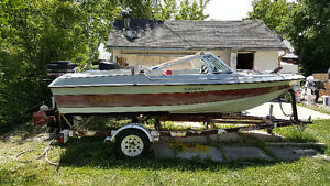 15 foot bowrider with 65HP merc