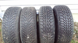 Four 14 inch studded winter tires on 5 bolt rims $300