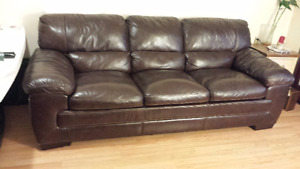 Nice chocolate 3 seat sofa in leather + electric. couch + table