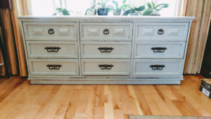 Solid wood 9 drawer dresser finished in a light distressed look