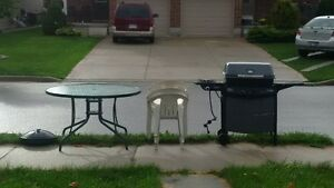 bbq, glass patio table, white plastic chairs on the curb Stratford Kitchener Area image 1
