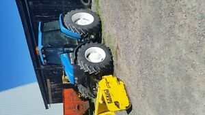 4X4 New Holland tractor with heavy snow blade
