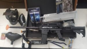 paintball markers and lots of accessories