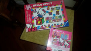 2 Hello Kitty Puzzles, one is a Ravensburger puzzle