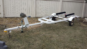 Boat trailer accommodate 12-14 ft boat. New spare Tire / carpet