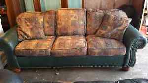 LEATHER/FABRIC COUCH. DELIVERY IS EXTRA