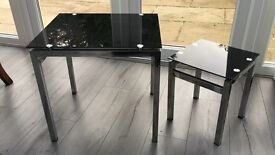 Set of two black, glass top side tables. Excellent condition. Can buy single one.