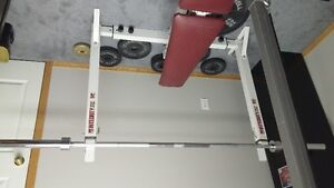 Weight bench with lat bar, leg curl attachments