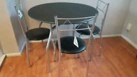 Brand new black dining table and 3 chairs