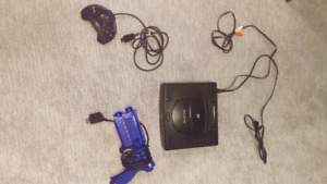 For sale or trade. Sega Saturn and 6 games and light gun