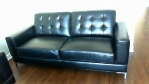 brand new black leather-look couch