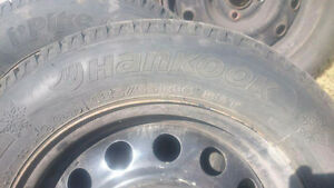 HANKOOK WINTER TIRES X4 ON STEEL RIMS. 185/65 R14 86T 4 bolt pat Kingston Kingston Area image 2