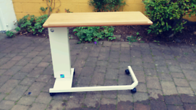 Easi-riser over bed table