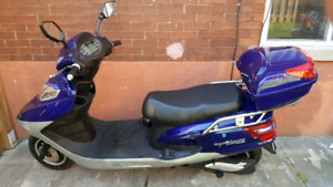 Selling two seater electric scooter.